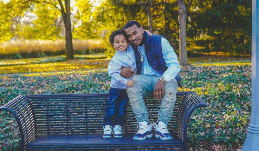 father and son on a bench